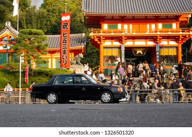 Kyoto, Japan - November 16, 2013: Taxi car and tourists in front of the gates of Yasaka shrine in Gion district during shichigosan 7 - 5 - 3 ceremony