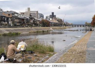Kyoto, Japan - November 17 2016 : Artist painting by the river of Katsura river in kyoto Japan