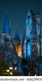 KYOTO, JAPAN - NOVEMBER 17, 2016 : Night scene close up of Hogwarts castle the school of wizardry in Harry Potter movies in Universal Studios Japan