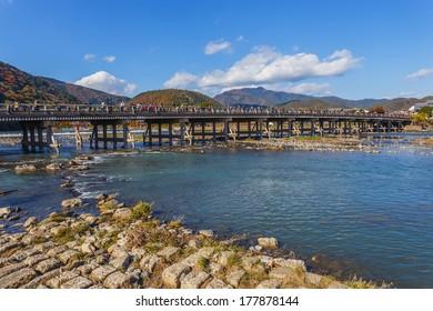 KYOTO, JAPAN - NOVEMBER 19: Togetsukyo in Kyoto, Japan on November 19, 2013. Togetsu-kyo Bridge is a landmark over 400 years, spans the Katsura River in front of Arashiyama Mountain