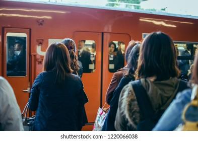 Kyoto , Japan - November 2, 2017 - Japanese people queuing for boarding a train in Kyoto. Japanese people queuing for boarding a train in Kyoto.