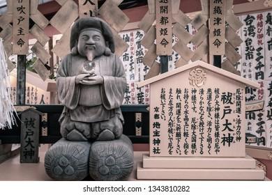 Kyoto, Japan -November 2, 2018: Okuninushi -god of love- stautue at Jinja-Jishu shrine inside the famous Kiyomizu-dera Buddhist Temple, in Gion District, Kyoto, Japan.
