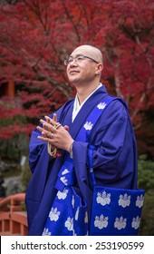 KYOTO, JAPAN - November, 20, 2014: Japanese Buddhist monk in traditional dress, Daigo-ji temple, Kyoto