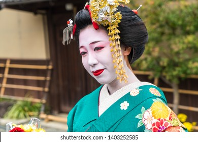 83cbc7952 Kyoto, Japan - November 2015: Portrait of young woman dressed as Geisha in  traditional