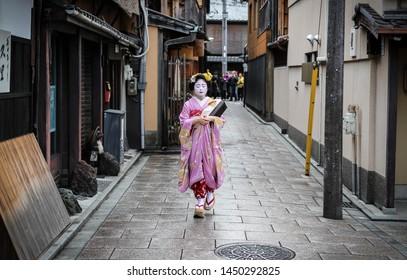 Kyoto, Japan - November 2016: Geisha walking in Gion's streets