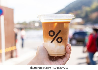 Kyoto, Japan - November 2019, % Arabica shop is located on Arashiyama is the most popular coffee shop in Kyoto. Store is in front of the Arashiyama Mountain, Ooi River and Togetsukyo Bridge.