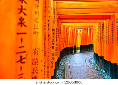 Kyoto, Japan - November 22, 2018 : View of the torii path lined with thousands of torii in the Fushimi Inari Taisha Shrine in Kyoto on November 22, 2018.