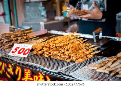 Kyoto, Japan - November 23, 2018: A Japanese type of skewered chicken selling at Arashiyama food stall with 500 Yen for 4 pieces