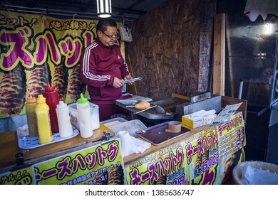 Kyoto, Japan - November 23, 2018: A Japanese food stall selling Korean street cheese corn dog with 500 Yen per piece.