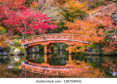 Kyoto, Japan - November 23, 2018: The vermilion-lacquered bridge and the pond in front completes the beautiful scenery at Daigoji-Temple.