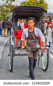 KYOTO, JAPAN - NOVEMBER 24: Pulled rickshaws in the park of Kyoto, Japan on November 24, 2015. Ricskshaws pulled by a men are a popular way of sightseeing old Kyoto (Gion) by tourists.