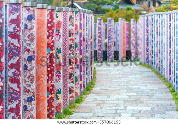 KYOTO, JAPAN - November 25, 2016 : Kimono forest of about 600 poles decorated with kimonos colored in the kyoyuzen style at Hankyu-Arashiyama Station Kyoto, Japan