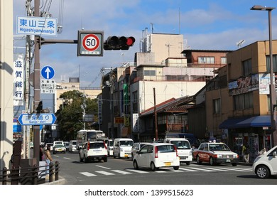 KYOTO, JAPAN - NOVEMBER 26, 2016: Traffic in Kyoto, Japan. 1,475,183 people live in Kyoto.