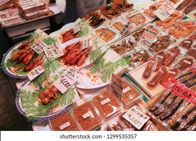 KYOTO, JAPAN - NOVEMBER 27, 2016: Japanese sea food delicacies at Nishiki Market in Kyoto, Japan. Nishiki is a popular traditional food market in Kyoto.