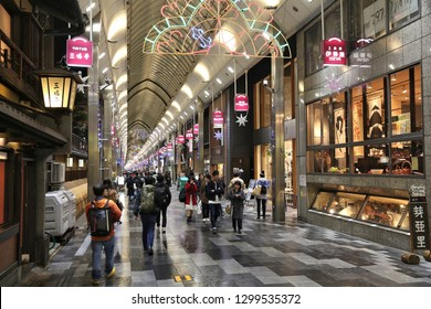 KYOTO, JAPAN - NOVEMBER 27, 2016: People shop at Teramachi-dori covered street arcade in Kyoto, Japan. Kyoto is a major city with population of 1.5 million.