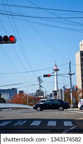 Kyoto, Japan - November 30, 2013: Taxi on a crossroad with Kyoto Tower landmark on the background