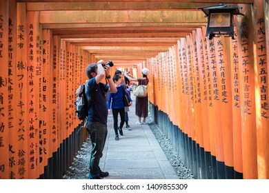 Kyoto, Japan: October 17, 2018:   Tourists at the Fushimi Inari-taisha in Kyoto, Japan.  Fushimi Inari Shrine is a popular tourist destination in Kyoto, Japan.