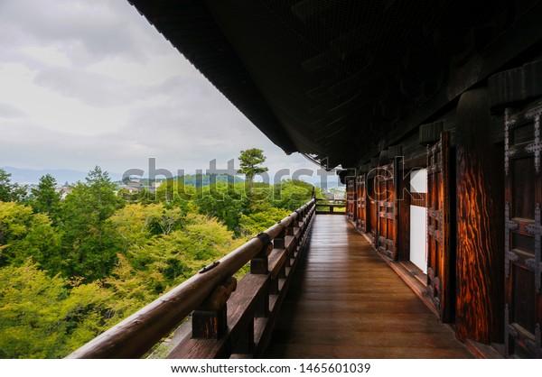 Kyoto, Japan - October 2, 2014: Sanmon gates of Nanzenji zen Buddhist temple surrounded by greenery