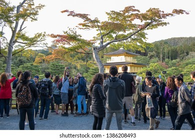 Kyoto, Japan: October 20, 2018:  Tourists at the Kinkaku-ji, a Zen Buddhist temple, on a sunny summer day, is one of the most popular buildings to visit in Japan.   It is a very popular tourist spot.