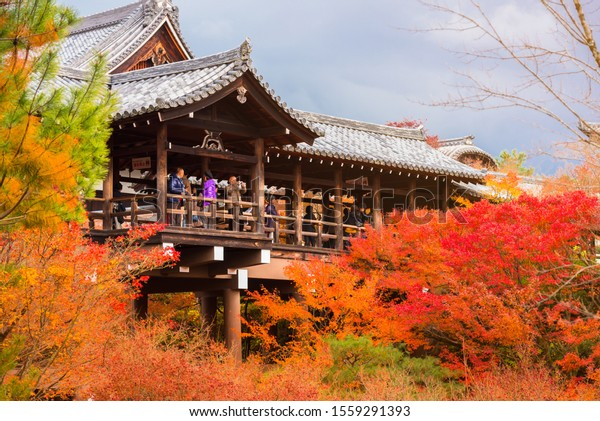 KYOTO, JAPAN - OCTOBER 20, 2019: Crowds gather at Tofukuji temple to celebrate the autumn maple leave festival in Kyoto, Japan.Tofukuji Temple with red maple leaves in autumn season
