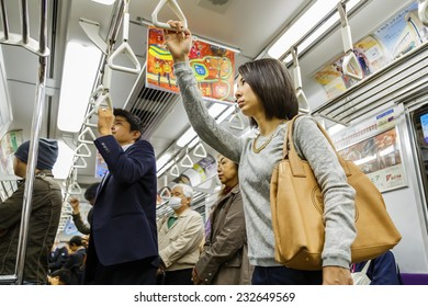 KYOTO, JAPAN - OCTOBER 21: Subway Commuter in Kyoto, Japan on October 21, 2014. Unidentified Japanese subway commuters catch a train to work in the morning
