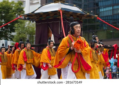 Kyoto, Japan, October 22, 2014 : Japanese people wearing yellow traditional costumes are marching during the Jidai Matsuri festival in Kyoto, Japan.
