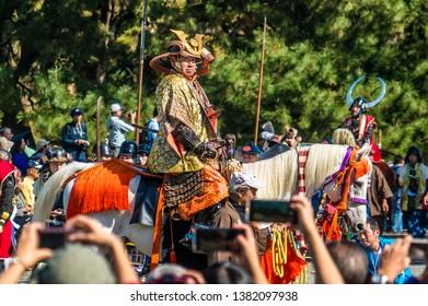 Kyoto, Japan - October 22, 2018: tourists taking photos of Toyotomi Hideyoshi samurai warlord during Jidai Matsuri festival procession at Kyoto Imperial Palace