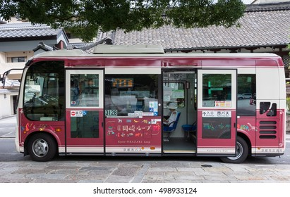 Kyoto, Japan - September 16, 2016: One of the many Kyoto City Bus vehicles. Wine-colored smaller bus with large windows.