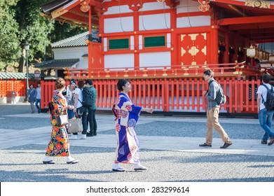 Kyoto, Japan - September 25, 2014: Japanese women wear Kimono in the Fushimi Inari Taisha Shrine in Kyoto.