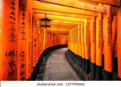 Kyoto, Japan - September 25 2018: Red Torii gates in Fushimi Inari Shrine in Kyoto, Japan. It is the famous landmark and tourist travel destination of Kyoto.