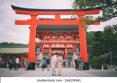 KYOTO, JAPAN - September 27, 2014: Fushimi Inari-taisha in Kyoto, Japan on November 19, 2013. The main shrine structure was built in 1499, reachable by a path lined with thousands of torii