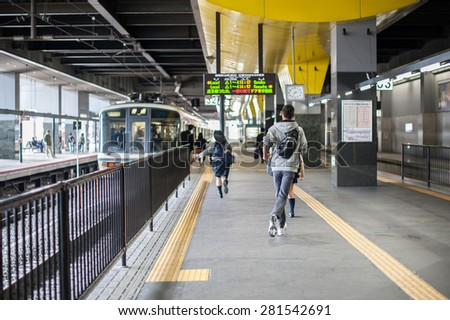 Kyoto, Japan - September 27, 2014: Student running to the train at train station, Japan.
