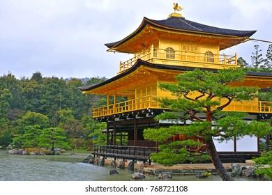 KYOTO, JP - APR. 10: Kinkakuji golden temple facade on April 10, 2017 in Kyoto, Japan. Kinkakuji officially named Rokuonji is a Zen Buddhist temple in Kyoto, Japan.