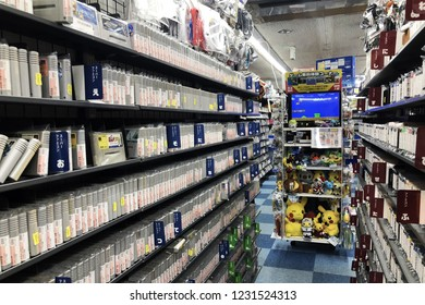 Kyoto, JP - NOVEMBER 7, 2018: Interior of the second hand games shop that have many game boxes, television and character dolls on the iron shelf.