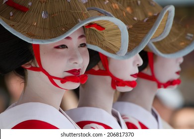 KYOTO - JULY 24: Unidentified Maiko girl (or Geiko lady) on parade of hanagasa in Gion Matsuri (Festival) held on July 24 2014 in Kyoto, Japan. It is one of Kyoto's renowned three great festivals.
