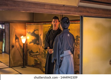 Kyoto - May 29, 2019: Iaido sensei and western student inside a Samurai house in Kyoto, Japan