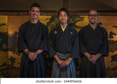 Kyoto - May 29, 2019: Iaido sensei and western students inside a Samurai house in Kyoto, Japan