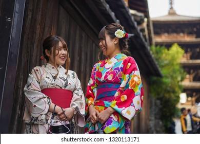 Kyoto - Nov. 19, 2018: Beautiful Japanese lady wearing Kimono with Yasaka Pagoda in background