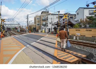 Kyoto - Nov. 20, 2018: Pedestrian is seen crossing railroad near Fushimi Inari Station
