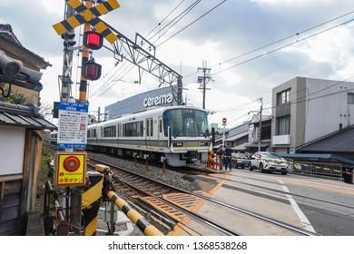 Kyoto - Nov. 20, 2018: Pedestrians are seen waiting to cross train railroad near Fushimi Inari Station