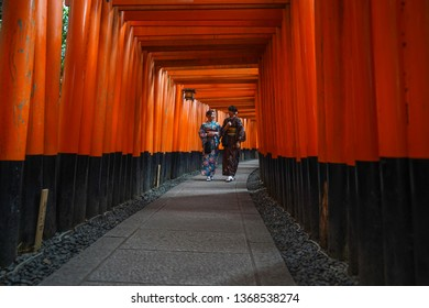 Kyoto - Nov. 20, 2018: Selective focus on Tori Gates with Japanese wearing kimono visiting Fushimi Inari