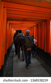 Kyoto - Nov. 20, 2018: Visitors are seen walking inside Tori Gates in Fushimi Inari