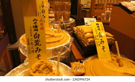 KYOTO, KYOTO PREFECTURE, JAPAN - DECEMBER 31, 2017; Display with different types of white miso (fermented soybean paste) in Nishiki Market, Kyoto. This light-colored miso has a mildly sweet flavor.