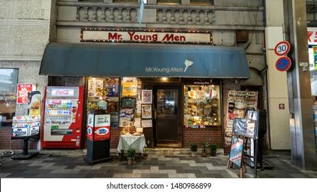 "KYOTO, KYOTO PREFECTURE, JAPAN - JULY 16, 2019: A well-established okonomiyaki/yakisoba restaurant in Teramachi shopping street named ""Mr. Young Men"", presenting the retro-style from Showa Era."