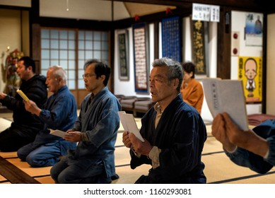 KYOTO PREFECTURE, JAPAN - NOVEMBER 18, 2015: Buddhist monks are praying when during ceremony at the temple in Kyoto Prefecture, Japan.