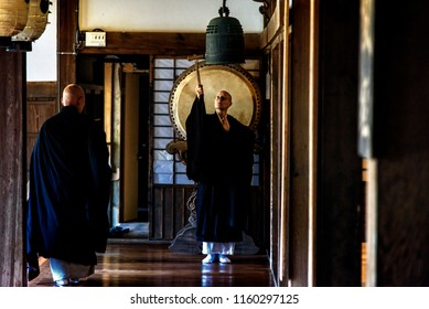 KYOTO PREFECTURE, JAPAN - NOVEMBER 18, 2015: Buddhist monk is ringing dharma gong for ceremony at the temple in Kyoto Prefecture, Japan.