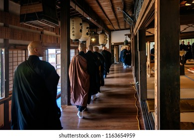 KYOTO PREFECTURE, JAPAN - NOVEMBER 18, 2015: Buddhist monks are walking to temple for ceremony in Kyoto, Japan.