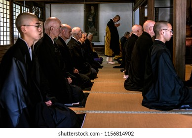 KYOTO PREFECTURE, JAPAN - NOVEMBER 25, 2015: Japanese and foreign Buddhist monks are ready for Ceremony at the temple in Kyoto, Japan
