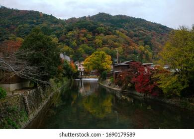 Kyoto Prefecture, Kansai, Japan - November 22, 2019 - Scene of Katsura river in Arashiyama park, viewed on the Togetsukyo bridge