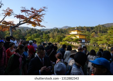 KYOTO,JAPAN - 27 November 2018: Tourists trying to get to best view of Kinkakuji. The Golden Pavilion is one of the most popular building in Japan.